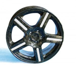 This wheel made of fiber-reinforced plastic is light weight and exhibits high structural durability.