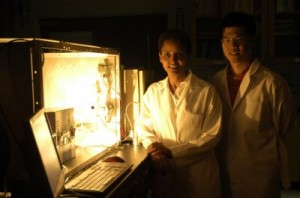 Sossina Haile and William Chueh stand next to the benchtop thermochemical reactor used to screen materials for implementation on the solar reactor.