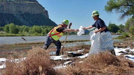 Workers continue cleaning up Yellowstone River. Officials estimate clean up will continue well into November.