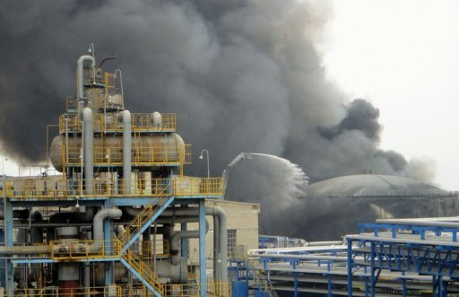 Firefighters battle a blaze at the PetroChina refinery in the northeast China city of Dalian.