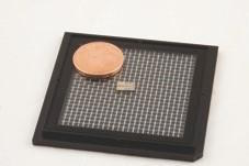 Using photonic integrated circuit technology, researchers made a tiny, yet fast quantum random number generator. The small chip in the middle of the picture contains two of the random number generators, which together measure 6 by 2 millimeters. For comparison, the coin is 16.25 millimeters in diameter.
