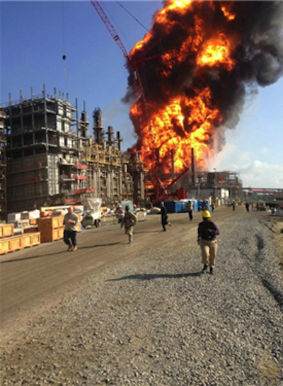 Workers flee the explosion and fire at Williams Olefins Plant in June, 2013.