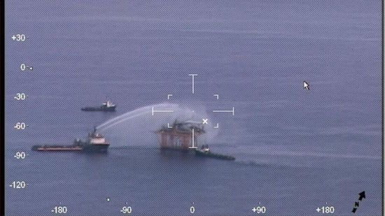 Vessels work to extinguish a fire aboard a Renaissance Offshore production platform Thursday.